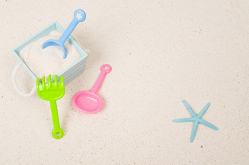 Plastic toys and sand bucket with star fish
