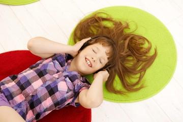 Schoolgirl having fun with headphones