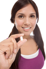 Hispanic teen girl with medicine pill