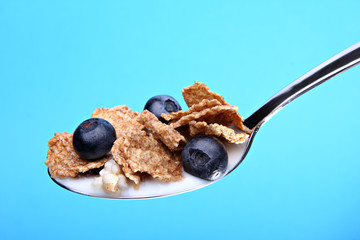 Cereal with blueberries on spoon