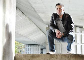 Young man under a bridge