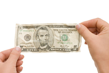 The crumpled banknote in a hand