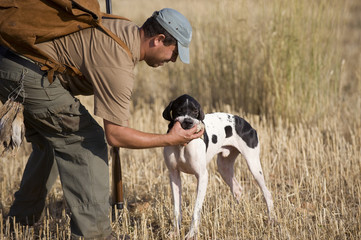 Cazador con su perro