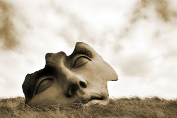 """Sculpture """"Light of the Moon"""" by Igor Mitoraj. Sepia toned image"""