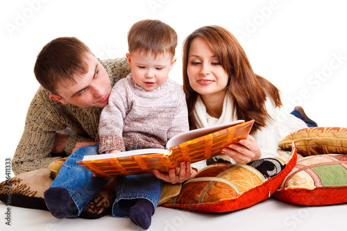 Mom and dad reading for the kid
