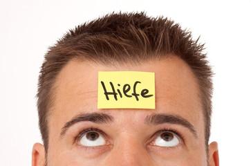 Haftnotiz auf der Stirn Hilfe