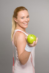 Beautiful woman holding an apple