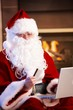 Santa Claus paying with credit card