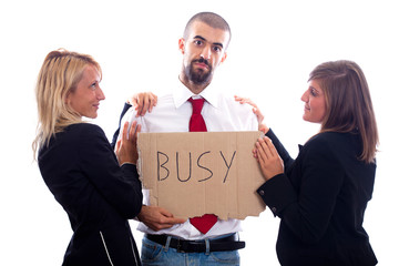Businessman Hold Busy Sign with Two Businesswoman Flirting
