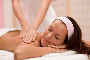 Luxury care - woman at back massage