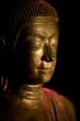 bouddha statue fond noir portrait