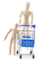Wooden dolls family go to supermarket with shopping cart