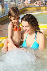 woman with her daughter in hot tub on cruise ship.