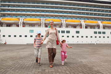 mother, daughter and son walking in dock and holding for hands,