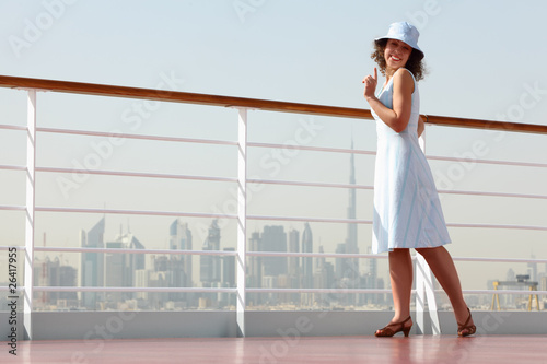 brunette woman standing on cruise liner deck