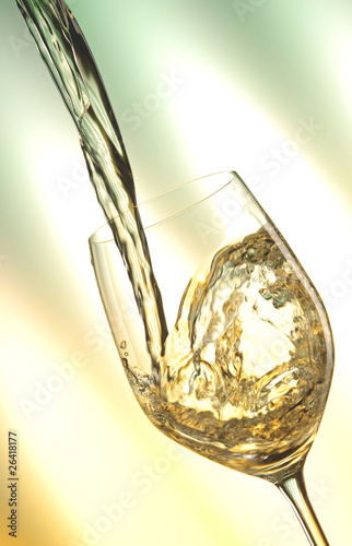 Pour white vine into glass with light background.