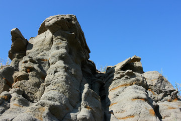 Grey sandstone deposits against a blue sky