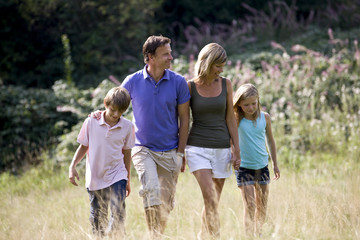 A family walking through a field, close-up