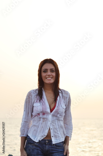 Young smiling  woman on the beach
