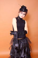 Portrait of goth woman wearing long black satin gloves