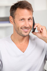 Man in the office talking on the phone