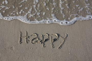 Happy - inscription on the beach