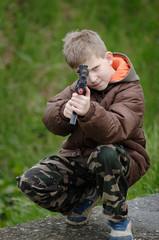 Young soldier with toy machine gun