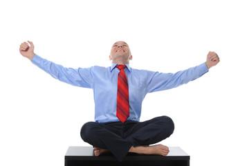 businessman meditating in yoga lotus
