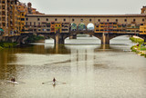 Rowing on Arno River Ponte Vecchio Covered Bridge Florence Italy poster