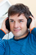 portrait of a handsome man listening music with earphones