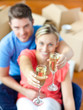 Young couple sitting on the floor in flat