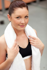 Portrait of a smart athletic woman with towel around the neck
