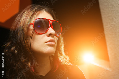 Cool woman in sunglasses playing vip rockstar