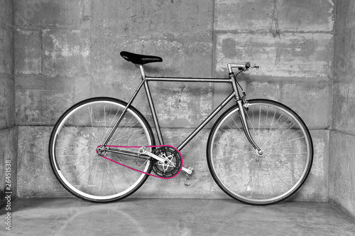 Bicycle A fixed-gear bicycle in black and white with a pink chain