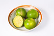 Lemons in a bowl on white back ground