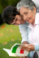 Grandma and grandson reading