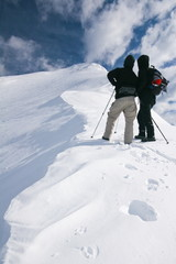 couple hiking in winter, julijan alps