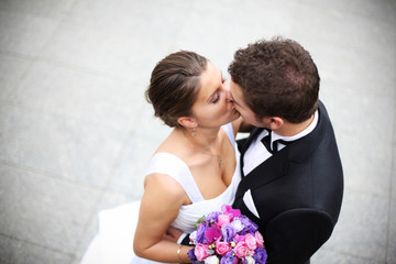 Young married couple kiss