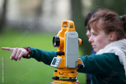 young land surveyor at work