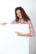 Woman showing white board on white background