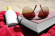 beach book sunglasses suncream towel 3
