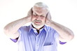 Senior man portrait headache