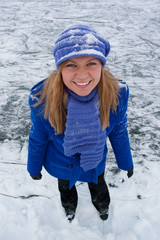 Smiling girl on ice skates.