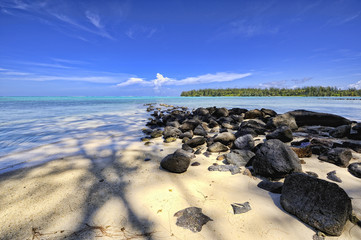 Stony pier on a beach of Papetoai, Moorea