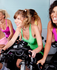 female cycling in fitness club