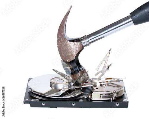 Leinwandbild Motiv Hard drive being destroyed with hammer, isolated