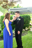 Teen Boy Kissing Prom Date's Hand