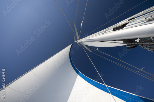 Sails and mast in the blue sky - 26489985