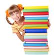 Schoolgirl holding pile of books. Isolated.
