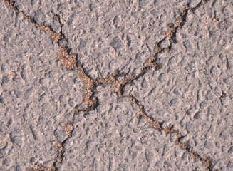 Asphalt road with crack wet crack